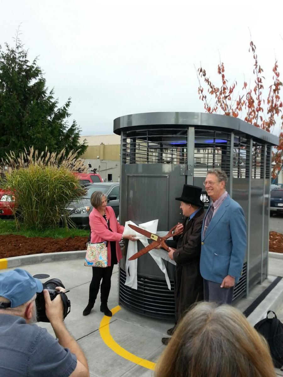 New Public Restroom Tied with Ribbon Being Cut
